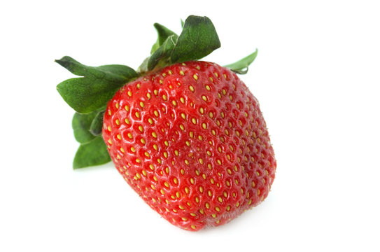 Red strawberry with green leaves on a white background