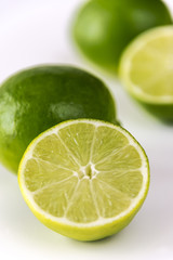 Close-up of cut lime isolated on white