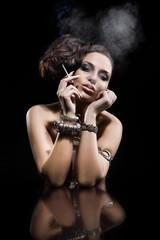 Fototapete - Beautiful young woman smoking a cigarette