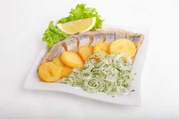 Fish with potatoes and onions