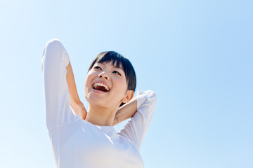 a young asian woman relaxing in the blue sky