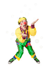 Cheerful clown in the soap bubbles
