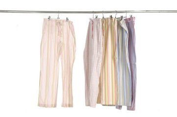 female dress shirt and trousers clothespins on rope