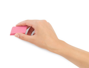 human hands with erase rubber