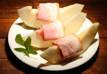 parma ham and melon, on wooden table
