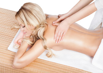 Woman having therapy massage of back in the spa salon.