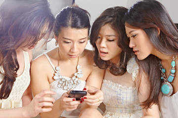 Girls paying with cell phone