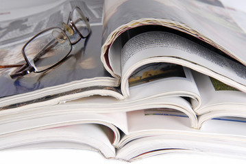 stack of magazine and glasses