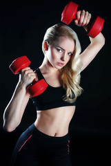 Portrait of attractive fitness woman with dumbbells