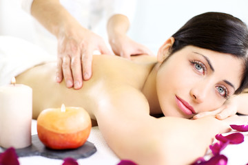 Young woman getting back massage in luxury spa