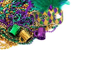 Wall Mural - Mardi gras beads on a white background with copy space