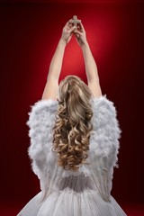 Angel praying holding crucifix