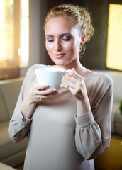 Young woman with cup of tea