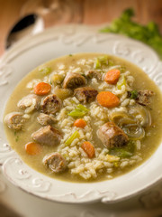 soup with rice and sausage, selective focus