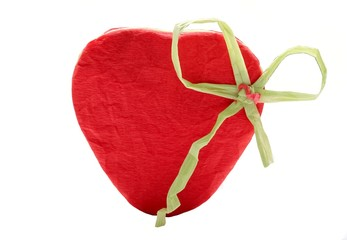Red heart from wrinkled paper isolated on white