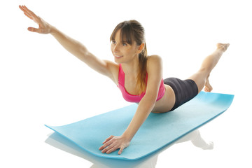 young fitness woman doing pilates exercise
