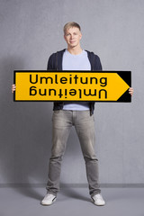 Man showing diversion sign.