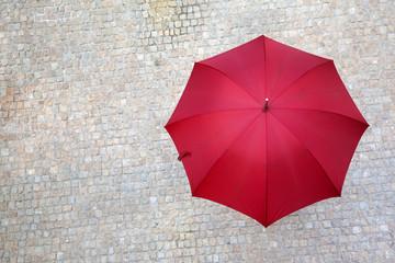 Obraz Red umbrella outdoors - fototapety do salonu
