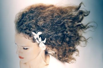 Curly hair elegant woman hairstyle