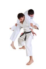 Karate. Men in a kimono with a white background.