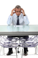 Businessman stressed over a document