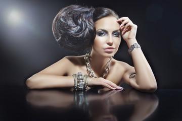 Wall Mural - Portrait of beautiful brunette woman wearing jewellery