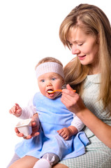 woman is feeding her baby