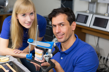 Two dental technicians with articulator