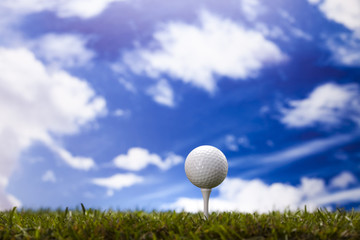 Golf ball on green meadow