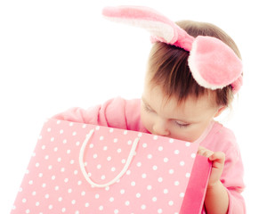 The little girl with pink ears bunny and bag.