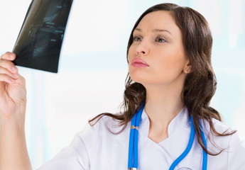 Female doctor looking at a testicles ultrasound results