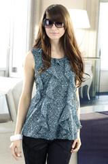 young fashion model in designer dress posing