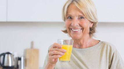 Mature woman drinking orange juice