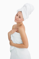 Happy young woman wrapped in towel
