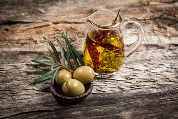 Green olives and olive oil with spice