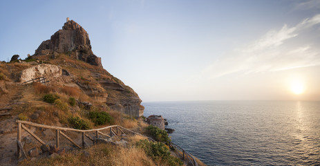 panorama of castle on Capraia island with rising sun, Elba