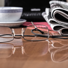pile of newspaper & glasses