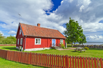 Traditional red Swedish cottage house