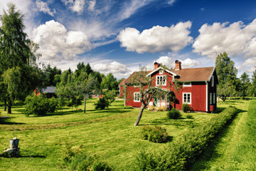 red cottages in rural landscape and powerful colors