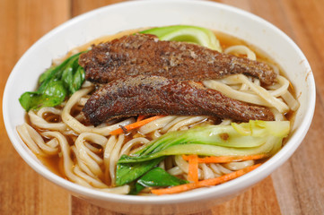 Yellow croaker noodles with vegetables