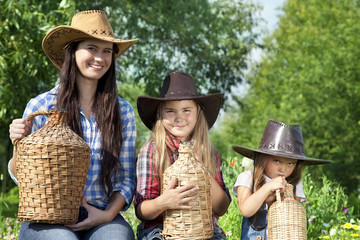 Portrait of cowgirls