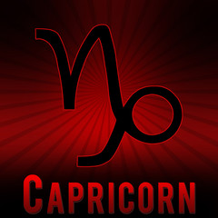 Capricorn symbol with a red background and black burst.