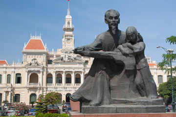 Statue Ho Chi Minh with a girl and Post Office in Saigon