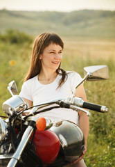Fototapete - Young biker woman on the country road