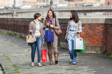 Beautiful Young Women Walking in the City with Shopping Bags