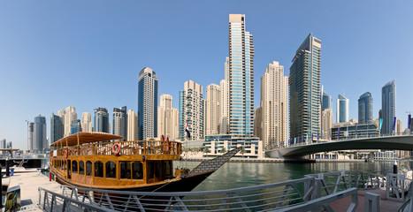 Dubai Marina port with skyscrapers