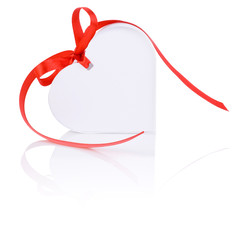 White gift in the form of heart with a bow of red ribbon Isolate