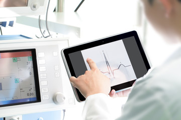 Doctor at work with a digital tablet