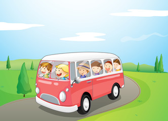 Little children riding in a bus