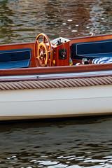 Stylish cutter boat on a Dutch canal